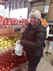 Customer Kathy Wilson in her fruit shop on the outskirts of Invercargill