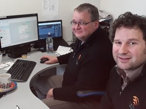 Glenn Hutton (left) and Travis Baird in Unifone's Balclutha office.