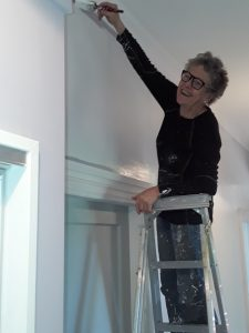 Customer Irene Walton decorates her new house, in the 4th town where she has been a happy Netspeed customer